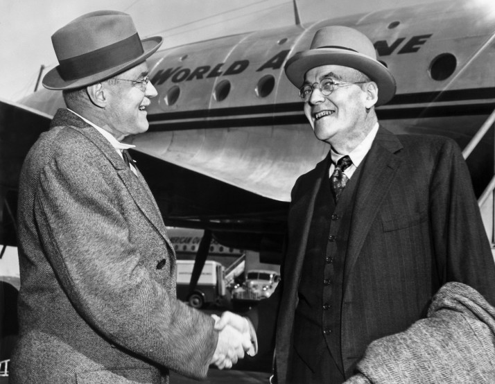 NEW YORK, UNITED STATES: John Foster Dulles (R), Republican Party Foreign policy expert is greeted by his brother, Allan Dulles, as he arrives 04 October 1948 in New York. J. F. Dulles was US Republican secretary of state (1953-9). When the USA entered WWII, A. Dulles was recruited by Colonel W. J. Donovan for the Office of Strategic Services (OSS), the US wartime espionage agency that antedated the CIA. After the CIA was established in 1951, he served as deputy director and in 1953 he was appointed director by President Eisenhower but fired by President Kennedy after the failure of the Bay of Pigs invasion in Cuba in April 1961. AFP PHOTO ACME NEWSPICTURES (Photo credit should read AFP/AFP/Getty Images)