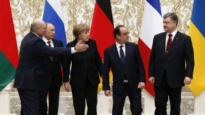 Leaders pose for a family photo during peace talks in Minsk